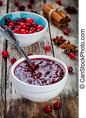 homemade cranberry sauce with anise and cinnamon on a rustic...