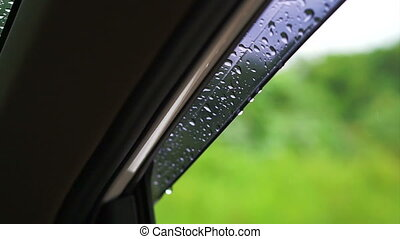 rain water droplets car windshied - rain water droplets on...