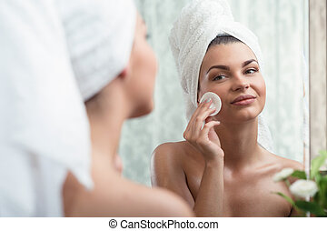 Woman removing make up - Photo of a happy woman removing...