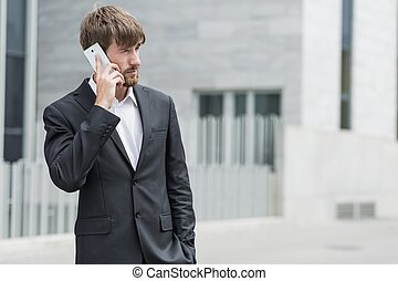 Man and mobile phone - Handsome man is talking on mobile...