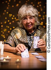 Fortuneteller using tarot cards to see the future