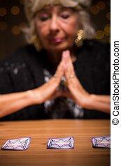Fortune teller forecasting future during spiritualistic...
