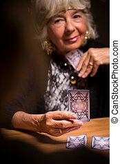 Tarot reader forecasting future - Female tarot card reader...