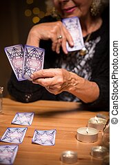 Reading future from tarot cards - Fortune teller reading...