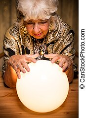 Forecasting future from crystal ball - Female seer...