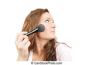 woman putting make up on her face - young woman putting make...