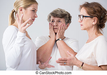 Family women talking together - Worried family women talking...