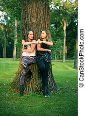 Young Teen Girl Friends Give Fist Pump - A Pair of Young...