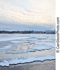 Thin ice in lake at winter morning