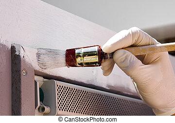 Painter - Hand in glove paints door in white