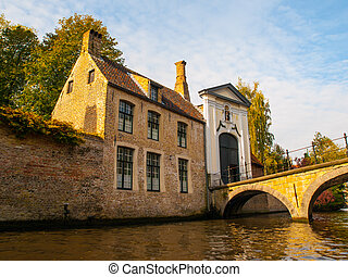 Bridge and entrance gate to Begijnhof in Bruges - Bridge and...