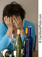 Too much to drink - Drunk woman with empty bottles of wine...