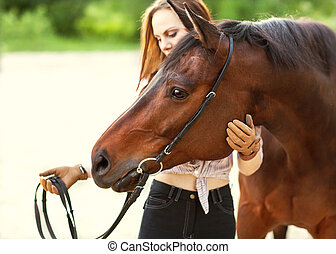 Beautiful woman and horse