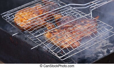 Chiken meat on barbeque grill smoke