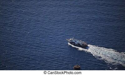 a small boat in the Aegean sea, nature in Greece - Santorini...