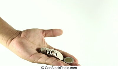 Hand holding a few coins in business