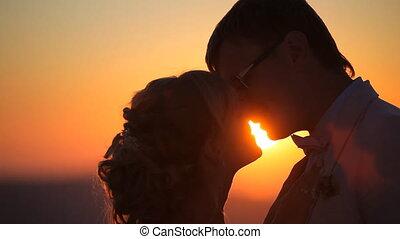 wedding in santorini couple kisses - couple at sunset,...