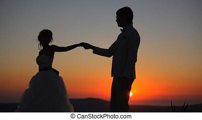 couple dancing on a background of a sunset - couple at...