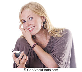 Teen listening to mp 3 player - Blonde girl listening to...
