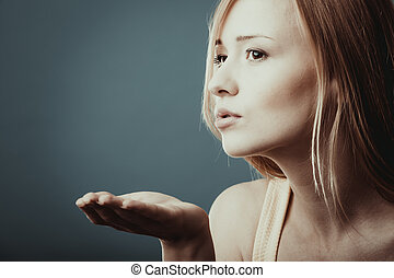 Young attractive woman sending hand kiss. - Young attractive...