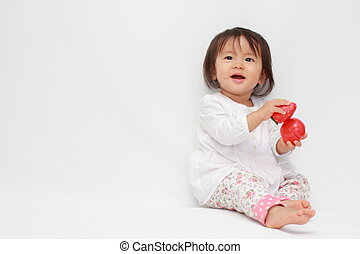 Japanese baby girl with a toy - Japanese baby girl playing...