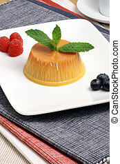 Flan dessert made with prime organic milk, berries and...
