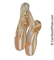 Ballet Slippers - Pink balley slippers hanging from their...