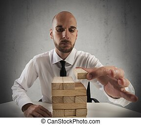 Construction business game - Businessman builds a tower with...