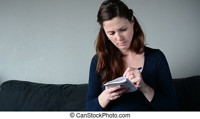 Woman thinking about to do list - Young woman in her...