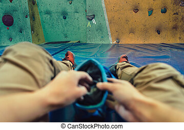 POV image of woman preparing to climb - Woman putting her...