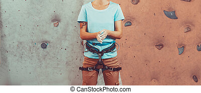 Climber woman coating her hands in magnesia - Climber young...