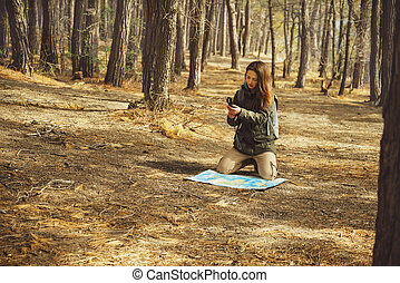 Hiker woman searching direction in the forest - Hiker young...