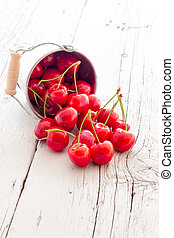 Ripe red cherry berries with white