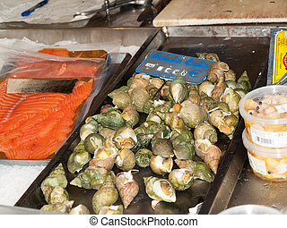 Big snails, escargots, stuffed with green sauce, from a...
