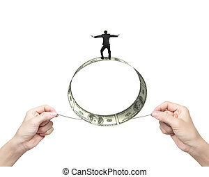 Two hands pulling rope businessman balancing roll of dollar...