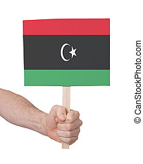 Hand holding small card - Flag of Libya - Hand holding small...