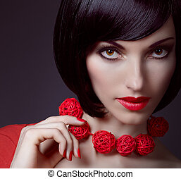 Fashion beauty portrait of brunette woman with stylish necklace
