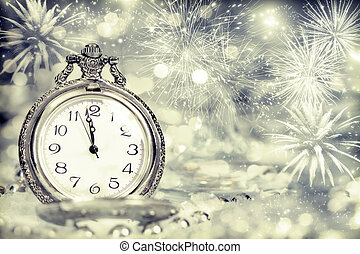 Old clock with fireworks and holiday lights - New Year's at...