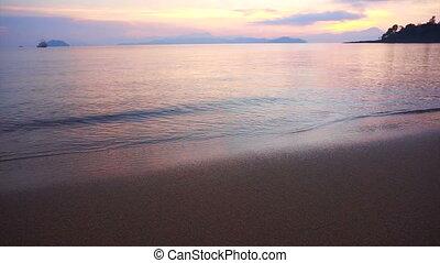 sunrise sand beach and calm sea - Video of beautiful sunrise...