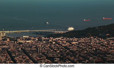 A ferry arrives to the port of Barcelona. Panorama of the...