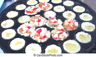 man cooking Kanom Krok Seafood - Kind Of Thai Sweetmeat...