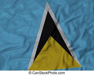 Ruffled flag of Saint Lucia - Closeup of ruffled Saint Lucia...