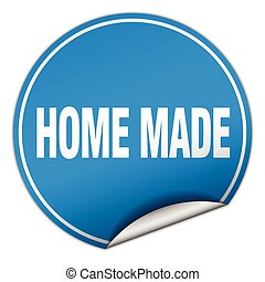home made round blue sticker isolated on white