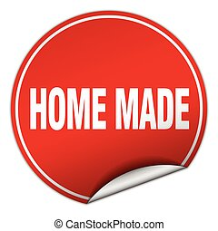home made round red sticker isolated on white