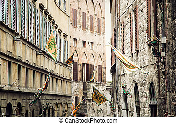 Street in the historic center of Siena, Italy - Street in...