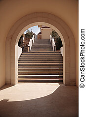 Stairs in arch - Step to the church, shined by the sun,...