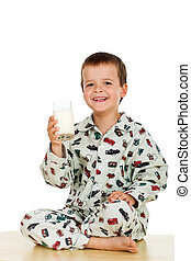 Happy healthy little boy with a glass of milk