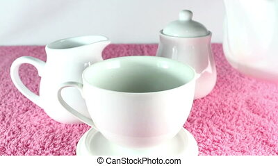 Pouring tea into cup - Pouring tea into white cup