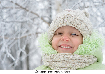 Happy little girl in winter - Happy little girl in warm...