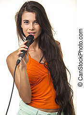 Beauteous woman in orange shirt with microphone. - Lovely...